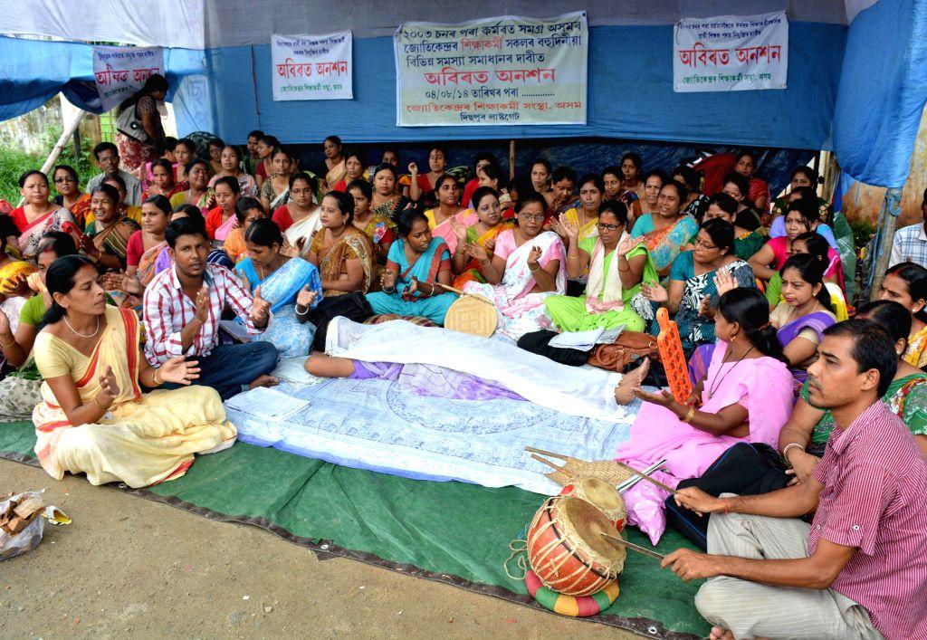 Jyotikendra Siksha Karmi activists demonstrate to press for their demands in Guwahati on Aug 13, 2014.