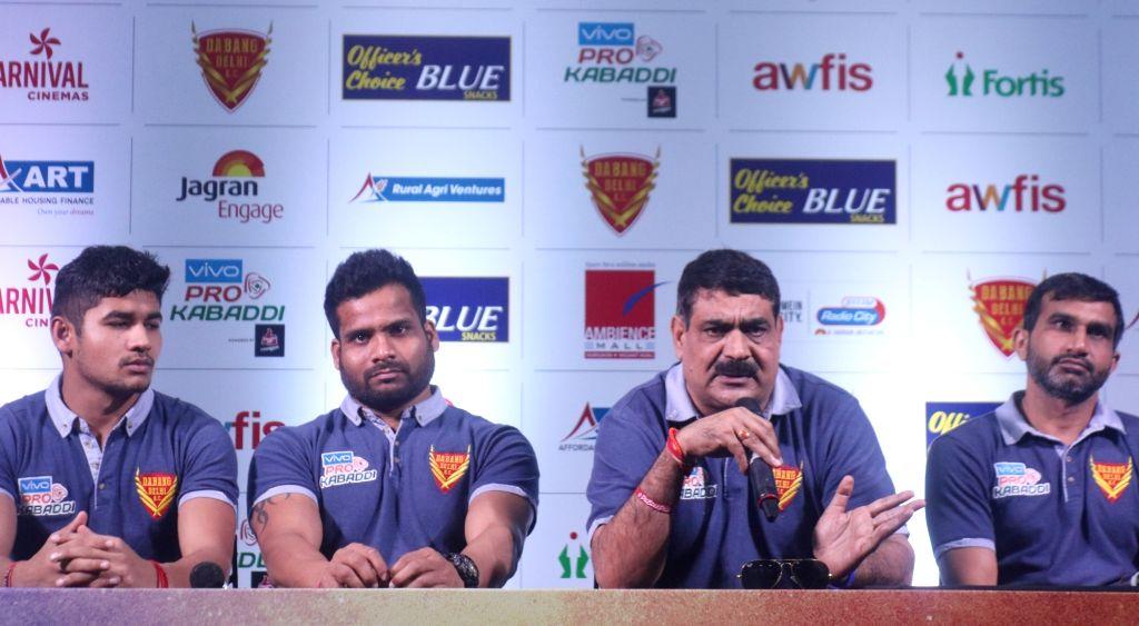 Kabaddi team Dabang Delhi coach Rambir Singh Khokhar accompanied by the team's players, addresses during a press conference on Pro Kabaddi League in New Delhi, on Nov 29, 2018. - Rambir Singh Khokhar