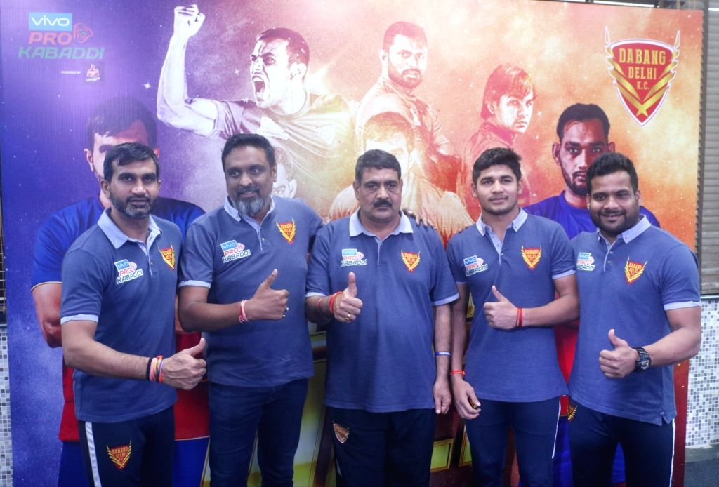 Kabaddi team Dabang Delhi coach Rambir Singh Khokhar along with the team's players during a press conference on Pro Kabaddi League in New Delhi, on Nov 29, 2018. - Rambir Singh Khokhar