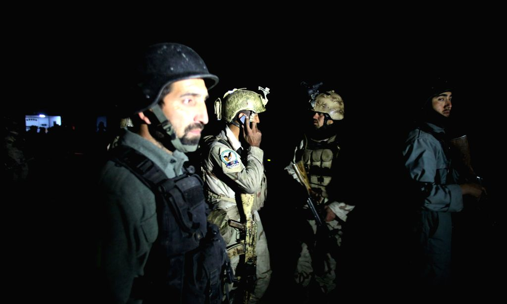 Kabul (Afghanistan): Afghan security forces gather near a building seized by Taliban militants in Kabul, Afghanistan, Nov. 29, 2014. Five people were killed and several others wounded after Taliban ..