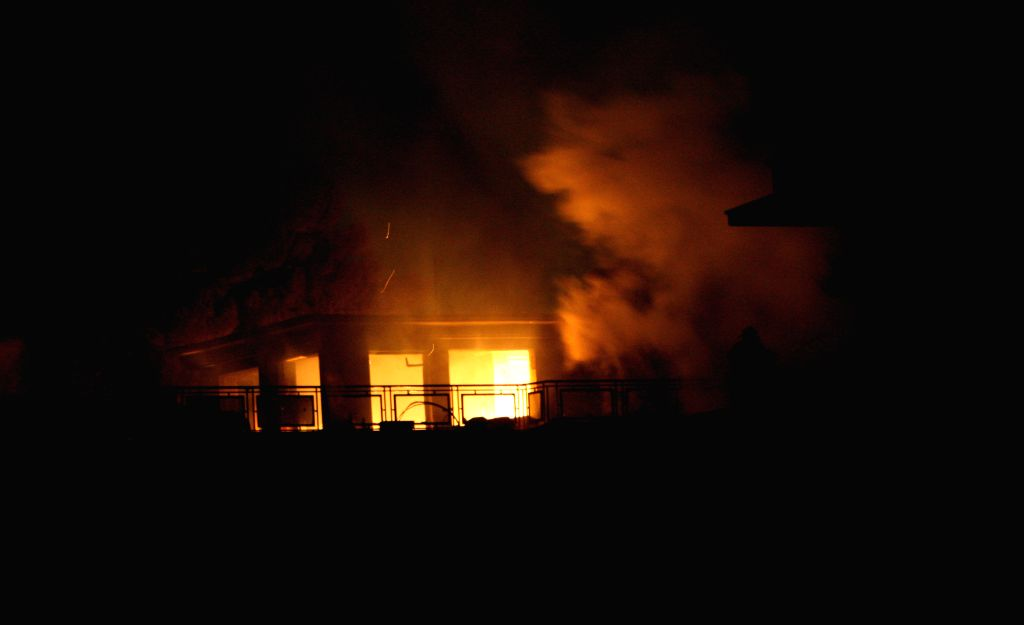 Kabul (Afghanistan): Smoke rises from a building seized by Taliban militants in Kabul, Afghanistan, Nov. 29, 2014. Five people were killed and several others wounded after Taliban gunmen stormed a ...