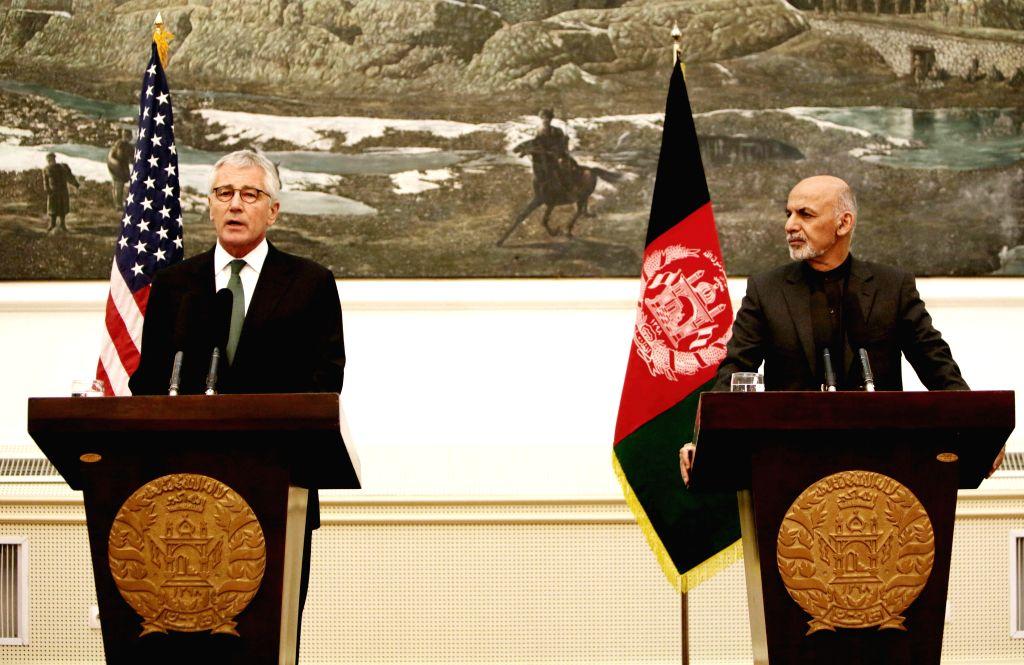 Kabul (Afghanistan): U.S. Defense Secretary Chuck Hagel (L) speaks during a joint press conference with Afghan President Mohammad Ashraf Ghani in Kabul, Afghanistan, Dec. 6, 2014. Visiting U.S. ...