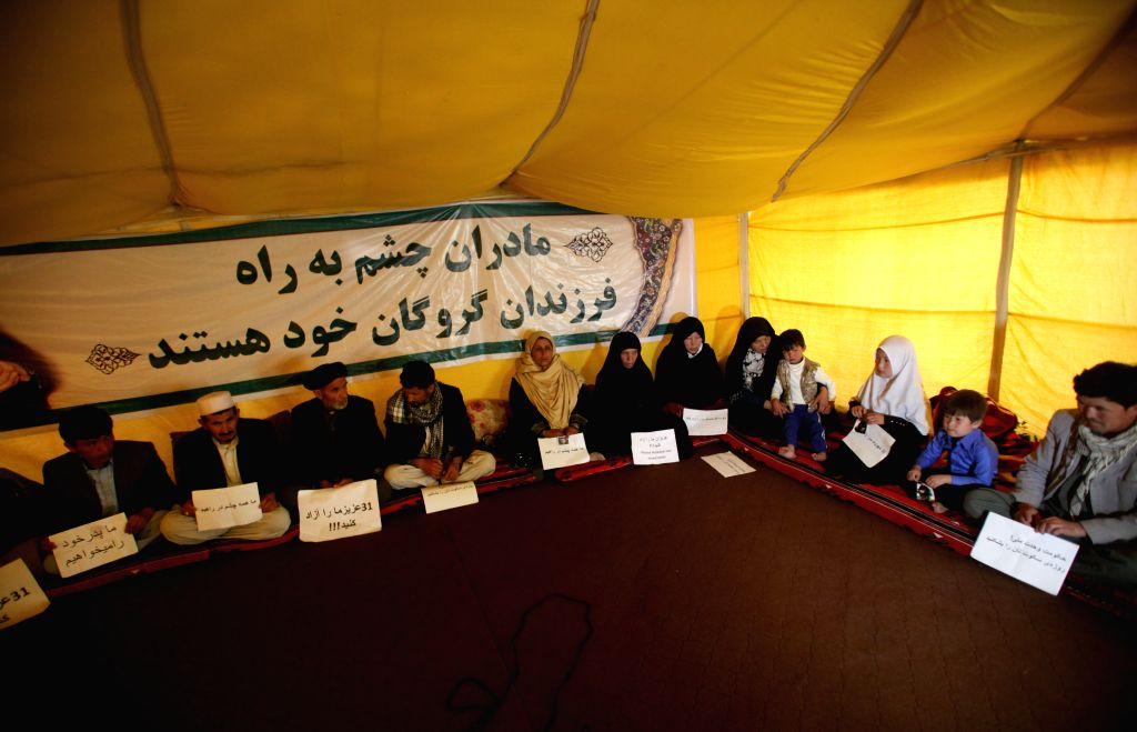 Family members of abducted passengers attend a sit-in protest near Presidential Palace in Kabul, Afghanistan on April 12, 2015. The protesters have been calling upon ...