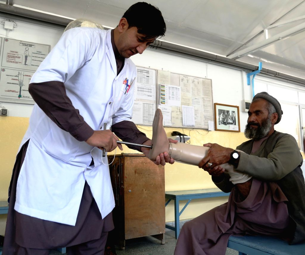 KABUL, April 18, 2016 - An Afghan doctor checks the prosthetic leg of a disabled man at the Orthopedic Center of the International Committee of the Red Cross (ICRC) in Kabul, capital of Afghanistan, ...