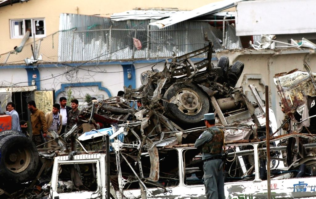 KABUL, April 19, 2016 - Afghan security force members inspect the site of a deadly attack in Kabul, capital of Afghanistan, on April 19, 2016. Death toll has risen to 28 while 327 others wounded in ...