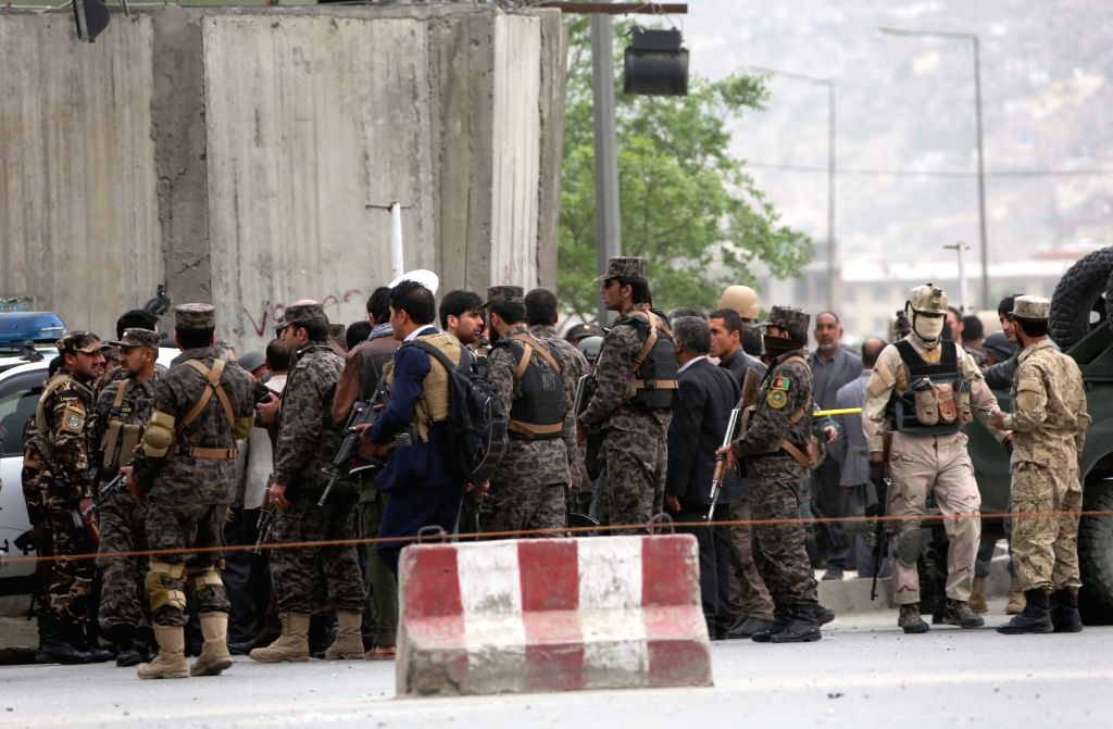 KABUL, April 19, 2016 - Afghan security personnel rush to the attack site in Kabul, capital of Afghanistan, on April 19, 2016. A powerful suicide bombing followed by gun shots have claimed several ...