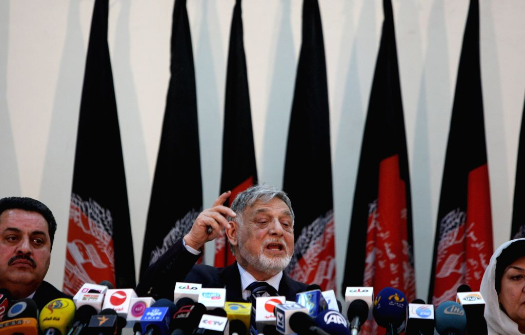 Independent Elections Commission (IEC) chief Ahmad Yousuf Nuristani (C) attends a press conference in Kabul, Afghanistan, on April 20, 2014. Presidential hopeful ...