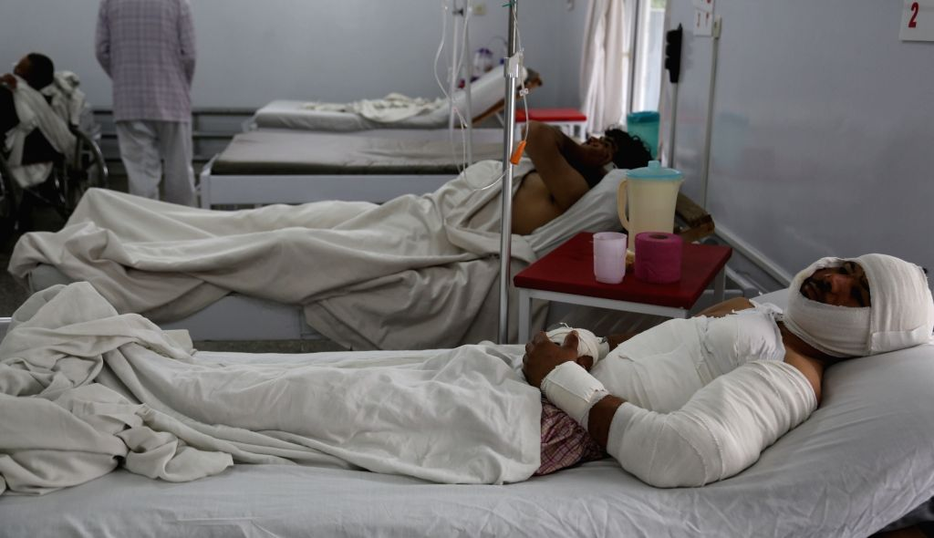 KABUL, April 20, 2016 - Injured men receive treatment at the Emergency Hospital after a suicide attack on Tuesday in Kabul, Afghanistan, April 20, 2016. The death toll of Tuesday's deadly bombing in ...
