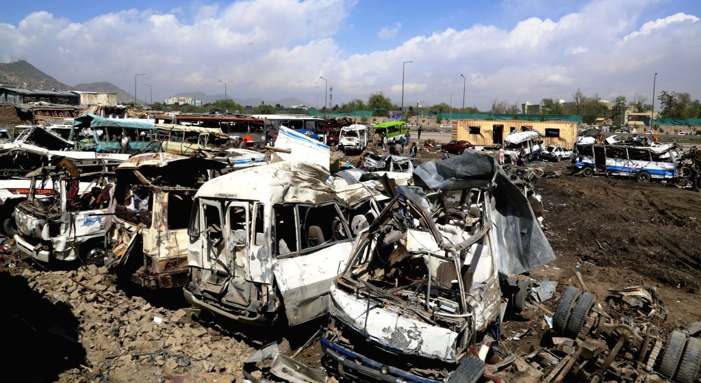 KABUL, April 21, 2016 - Photo taken on April 21, 2016 shows destroyed vehicles at the site of a truck bombing attack in Kabul, Afghanistan. The truck bombing on Tuesday destroyed dozens of nearby ...