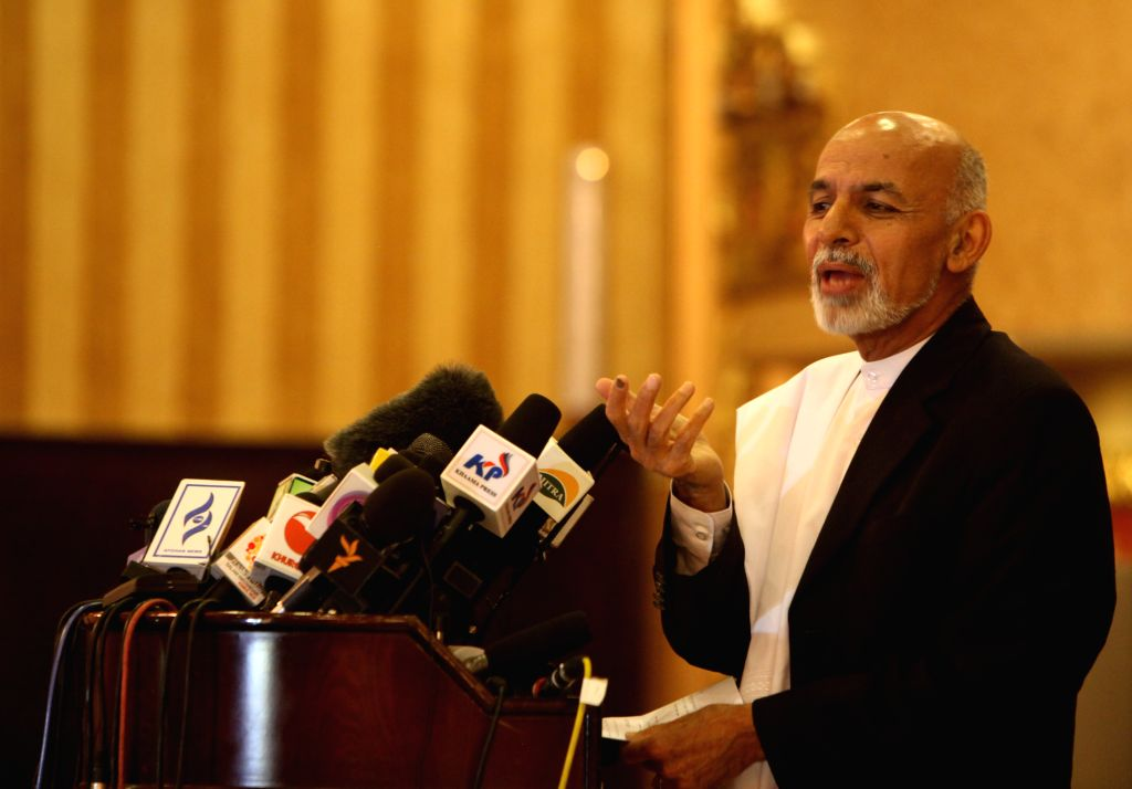 Afghan presidential candidate Dr. Ashraf Ghani Ahmadzai speaks during a press conference in Kabul, Afghanistan, April 27, 2014. Afghan presidential candidate Dr. ...