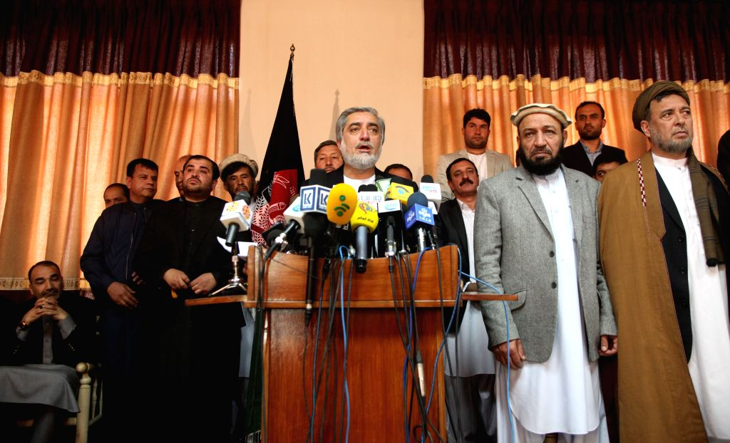 Afghan presidential candidate Abdullah Abdullah (C) speaks during a press conference in Kabul, capital of Afghanistan, on April 27, 2014. Abdullah Abdullah on Sunday