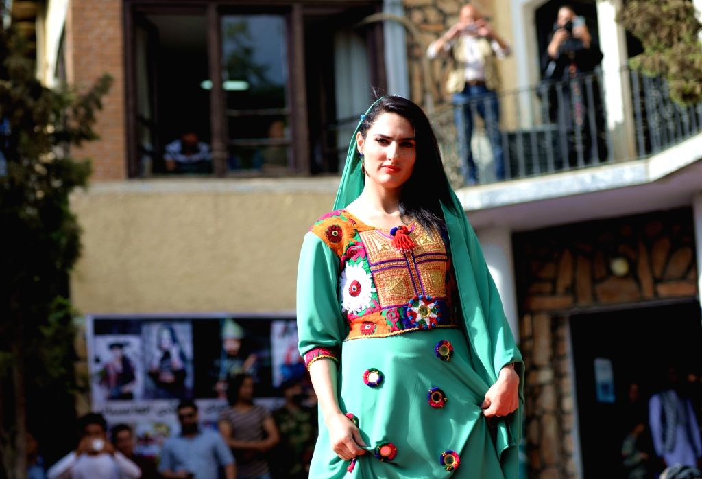 KABUL, Aug. 11, 2017 - A model presents a costume during a fashion show in Kabul, Afghanistan, on Aug. 10, 2017. More than 20 models including six girls attired in colorful dress attended the catwalk ...