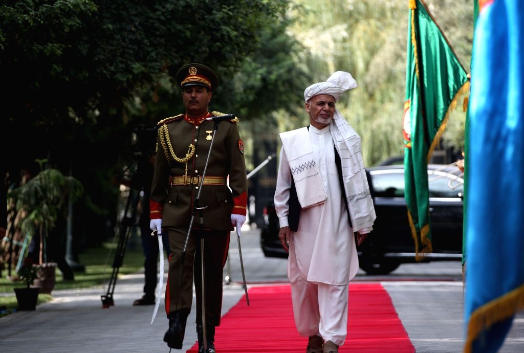 KABUL, Aug. 11, 2019 - Afghan President Mohammad Ashraf Ghani (R) reviews the guards of honor during an Eid al-Adha prayer at the Presidential Palace in Kabul, Afghanistan, Aug. 11, 2019. Afghan ...