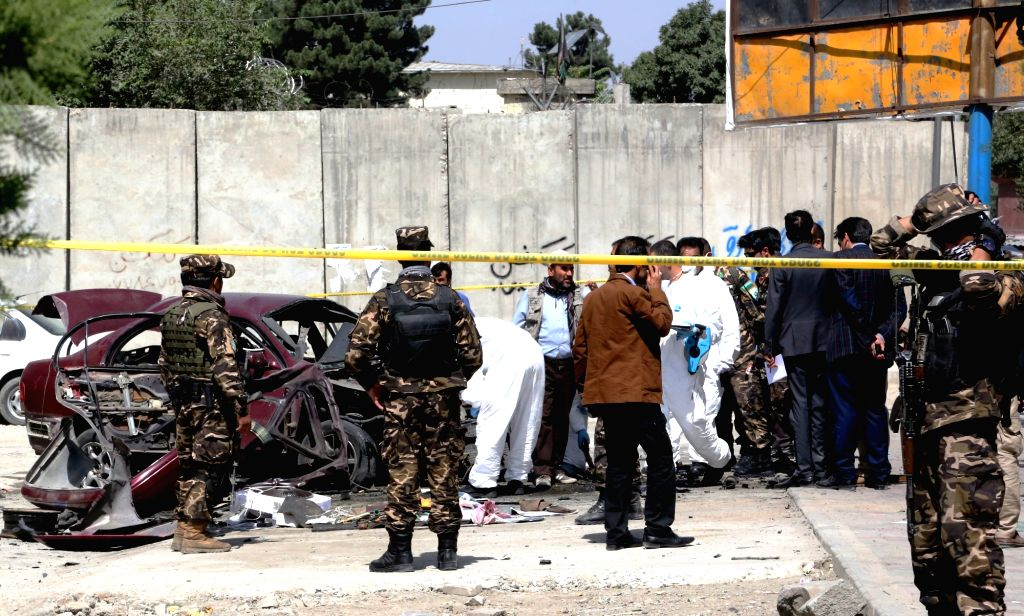 KABUL, Aug. 15, 2016 - Afghan security personnel inspect the site of blast in Kabul, capital of Afghanistan, Aug. 15, 2016. Three Afghans were injured in a bomb attack in central Kabul on Monday, a ...
