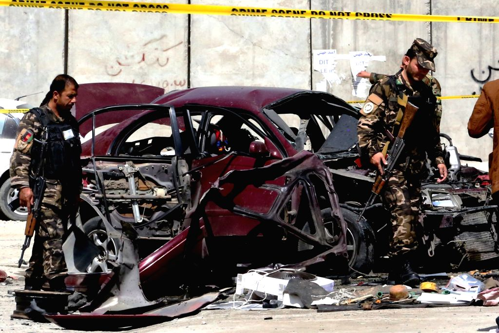 KABUL, Aug. 15, 2016 - Afghan security personnel inspect the site of a blast in Kabul, capital of Afghanistan, Aug. 15, 2016. Three Afghans were injured in a bomb attack in central Kabul on Monday, a ...