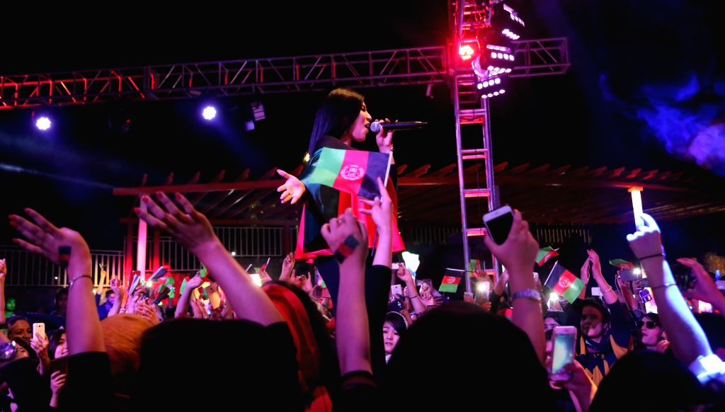 KABUL, Aug. 20, 2017 - Afghan female singer Aryana Saeed (C) performs during a concert to celebrate the 98th Independence Day anniversary of Afghanistan in Kabul, Afghanistan, on Aug. 19, 2017. It is ...