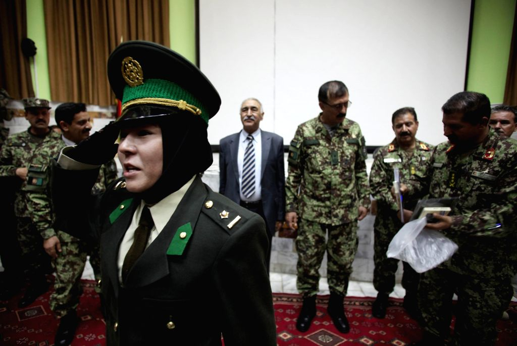 A newly-graduated female Afghan National Army (ANA) officer salutes during the graduation ceremony in Kabul, Afghanistan on Aug. 24, 2014. A total of 30 female army ..