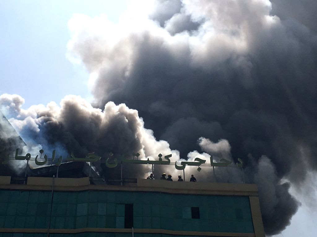 KABUL, Aug. 4, 2016 - Photo taken on Aug. 4, 2016 shows the burning building in Kabul, capital of Afghanistan. A business center in the western edge of Afghan capital Kabul city caught fire on ...