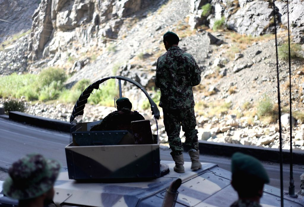 Afghan National Army soldiers are seen at a checkpoint on the outskirts of Kabul, Afghanistan, Aug. 6, 2014. Two insider attacks presumably organized by Taliban ...