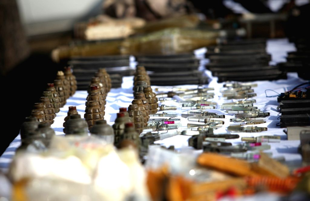 Photo taken on Dec. 10, 2013 shows terrorists' ammunitions captured by Afghan security forces displayed in Kabul, capital of Afghanistan. Afghanistan's