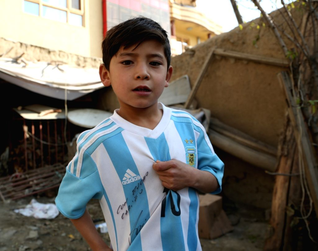 KABUL, Dec. 10, 2018 - Afghanistan little Messi fan Murtaza Ahmadi wears a jersey signed by Argentina soccer player Lionel Messi in Kabul, capital of Afghanistan, Dec.8, 2018.