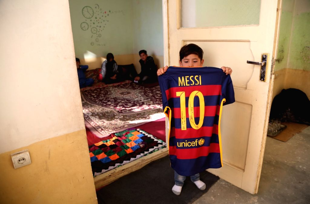 KABUL, Dec. 10, 2018 - Afghanistan little Messi fan Murtaza Ahmadi shows a jersey signed by Argentina soccer player Lionel Messi in Kabul, capital of Afghanistan, Dec.8, 2018.