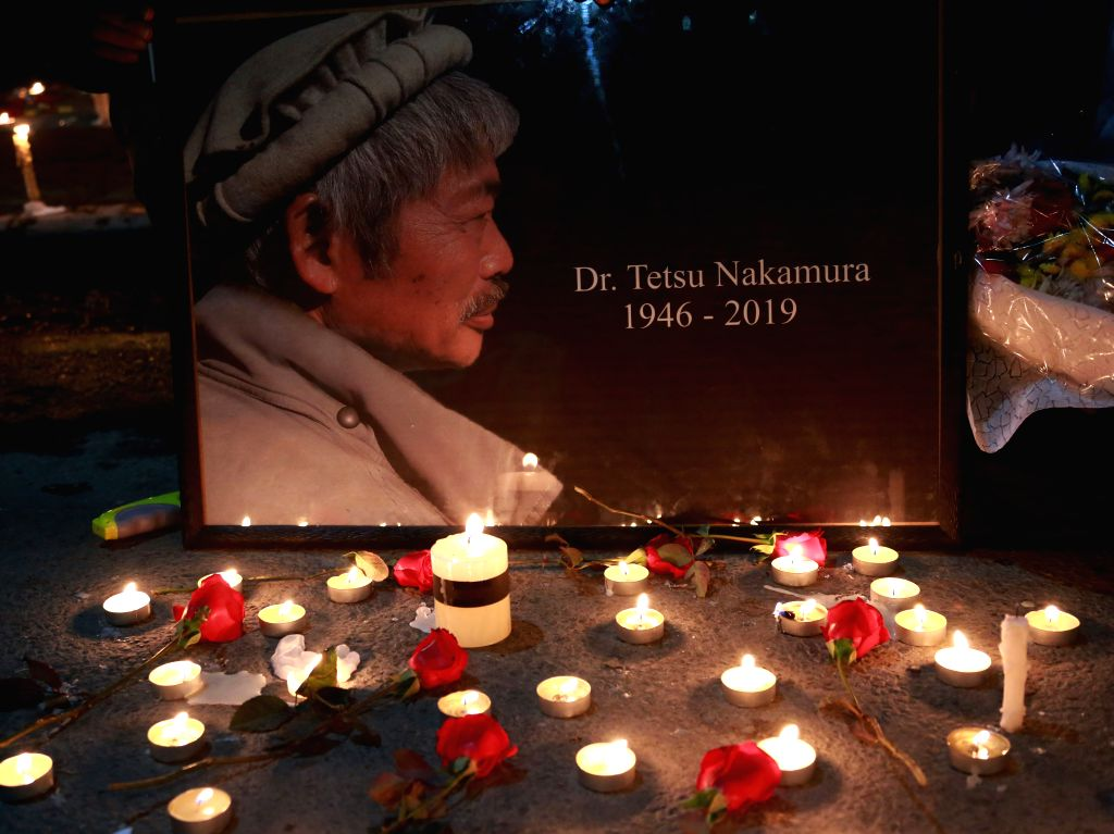 KABUL, Dec. 6, 2019 - Candles are seen at a vigil to express sorrow over the killing of Japanese aid worker Tetsu Nakamura by unknown armed men in Kabul, Afghanistan, Dec. 5, 2019. Afghans from all ...