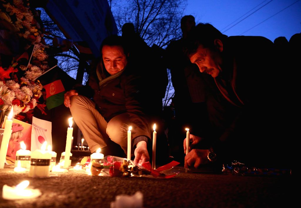 KABUL, Dec. 6, 2019 - People attend a vigil to express sorrow over the killing of Japanese aid worker Tetsu Nakamura by unknown armed men in Kabul, Afghanistan, Dec. 5, 2019. Afghans from all walks ...