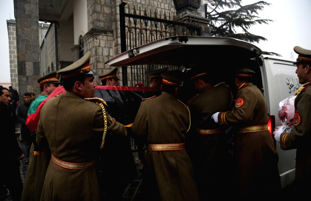 KABUL, Feb. 13, 2019 (Xinhua) Afghan honor guard carry the coffin of Afghan former president Sibghatullah Mujaddadi during a funeral ceremony in Kabul, capital of Afghanistan, Feb. 13, 2019. The body of former Afghan President Sibghatullah Mujaddadi