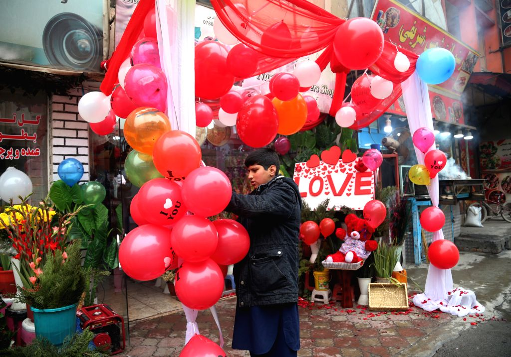 KABUL, Feb. 14, 2018 - An Afghan vendor arranges balloon for customers at his shop on Valentine's Day in Kabul, capital of Afghanistan, on Feb. 14, 2018.