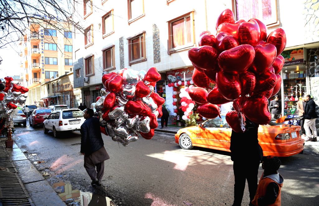 KABUL, Feb. 14, 2019 - Afghan men sell heart-shaped balloons on Valentine's Day in Kabul, capital of Afghanistan, Feb. 14, 2019.