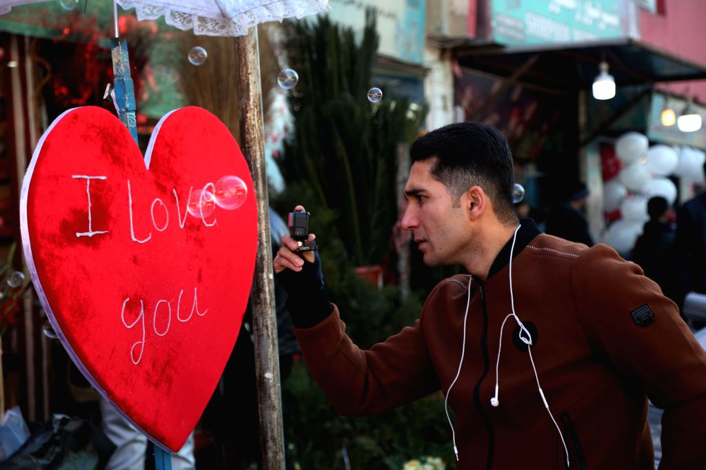 KABUL, Feb. 14, 2019 - An Afghan man captures video on Valentine's Day in Kabul, capital of Afghanistan, Feb. 14, 2019.