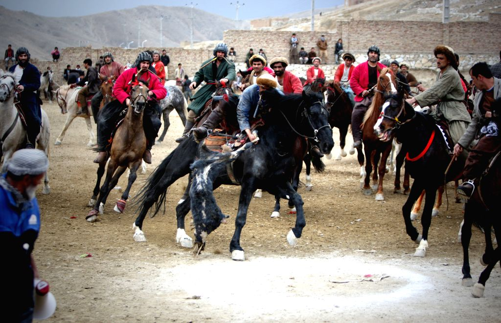 Afghan horsemen compete for the goat carcass during a game of Buzkashi in Kabul, Afghanistan, Feb. 19, 2015. Buzkashi is an Afghan national sport which is played ...