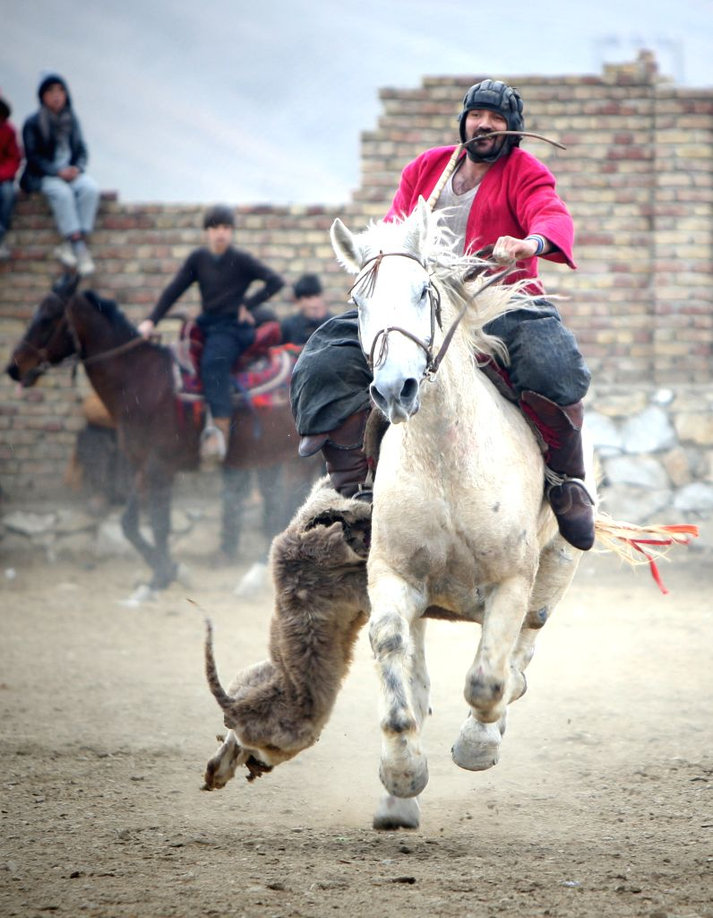 An Afghan horseman competes during a game of Buzkashi in Kabul, Afghanistan, Feb. 19, 2015. Buzkashi is an Afghan national sport which is played between two teams of ...