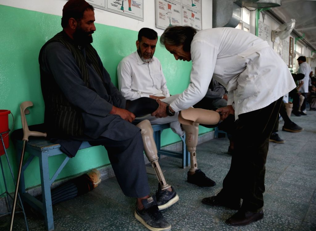 KABUL, Feb. 25, 2019 - A doctor checks the prosthetic leg of a man with disability at the Orthopedic Center of the International Committee of the Red Cross (ICRC) in Kabul, capital of Afghanistan, ...