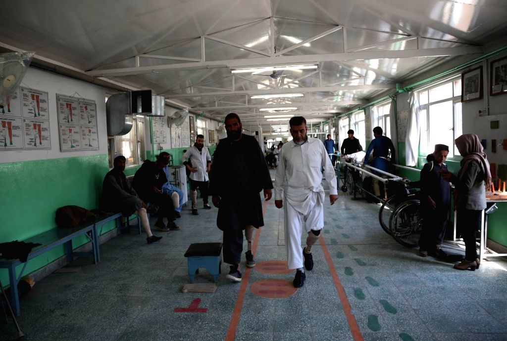 KABUL, Feb. 25, 2019 - Men with disability walk with prosthetic legs at the Orthopedic Center of the International Committee of the Red Cross (ICRC) in Kabul, capital of Afghanistan, Feb. 25, 2019. ...