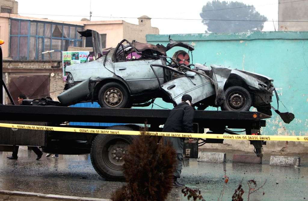 A destroyed vehicle is seen following a blast in Kabul, Afghanistan, Jan. 13, 2015. Two civilians were killed while two others wounded in a bomb attack in Afghan ...