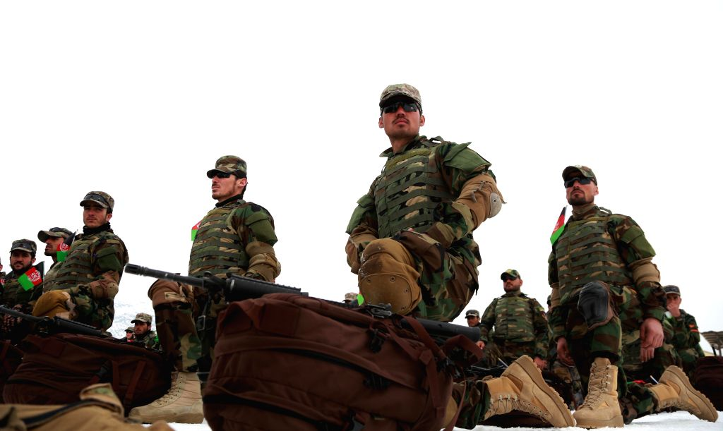 KABUL, Jan. 14, 2020 (Xinhua) -- Afghan commando force members take part in their graduation ceremony at Afghan National Army Special Operations Corps in Kabul, capital of Afghanistan, Jan. 13, 2020. A total of 1,123 new cadets have graduated from a