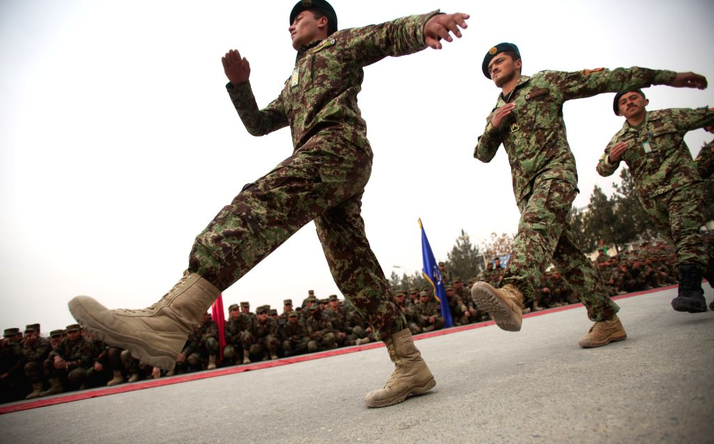 Afghan National Army officers march during their graduation ceremony in Kabul, Afghanistan, Jan. 18, 2015. A total of 200 officers graduated after two-month's ...