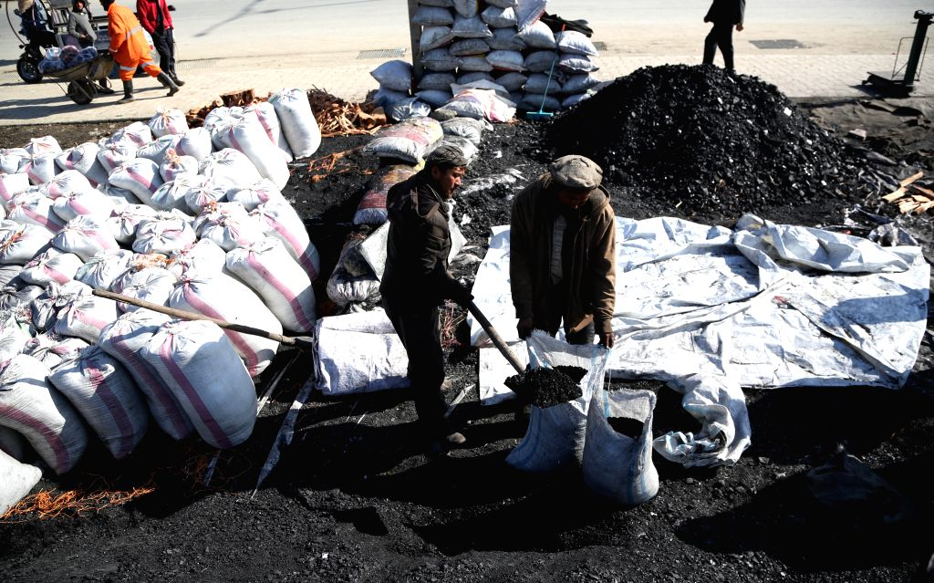 KABUL, Jan. 22, 2019 - Afghan men work at a coal market in Kabul, capital of Afghanistan, Jan. 22, 2019.