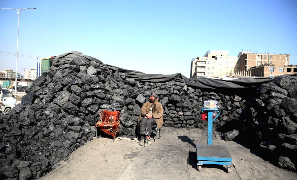 KABUL, Jan. 22, 2019 - An Afghan man waits for customers at a coal market in Kabul, capital of Afghanistan, Jan. 22, 2019.