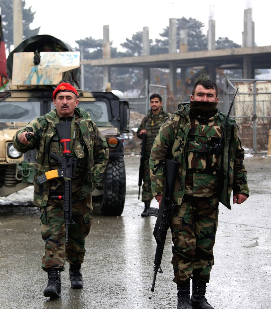 KABUL, Jan. 29, 2018 - Afghan army soldiers stand outside Marshal Fahim National Defense University after attack in Kabul, Afghanistan, Jan. 29, 2018. Militants' attack on a Afghan military base in ...