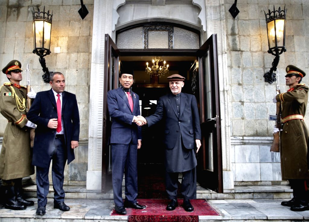KABUL, Jan. 29, 2018 - Afghan President Mohammad Ashraf Ghani (2nd R) shakes hands with Indonesian President Joko Widodo at the Presidential Palace in Kabul, Afghanistan, on Jan. 29, 2018. Indonesian ...