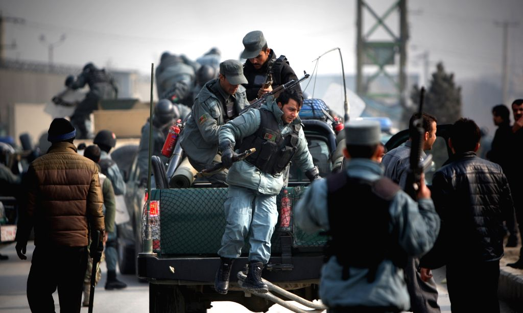 Afghan policemen arrive during an angry protest against caricatures published in French magazine Charlie Hebdo in Kabul, Afghanistan on Jan. 31, 2015. At least five ..