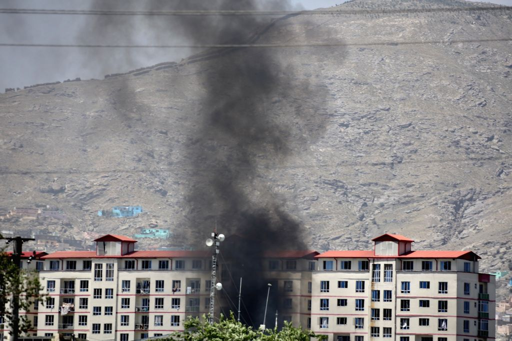 KABUL, July 1, 2019 (Xinhua) -- Smoke rises from the blast site in Kabul, capital of Afghanistan, July 1, 2019. Up to 34 people have been confirmed dead and 68 injured people have been taken to hospitals after a powerful blast rocked Kabul in the mor