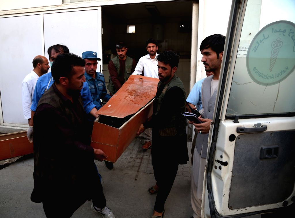 KABUL, July 15, 2018 - People carry the coffin of a victim of a suicide attack at a local hospital in Kabul, capital of Afghanistan, July 15,2018.  At least eight people, including an assailant, were ...