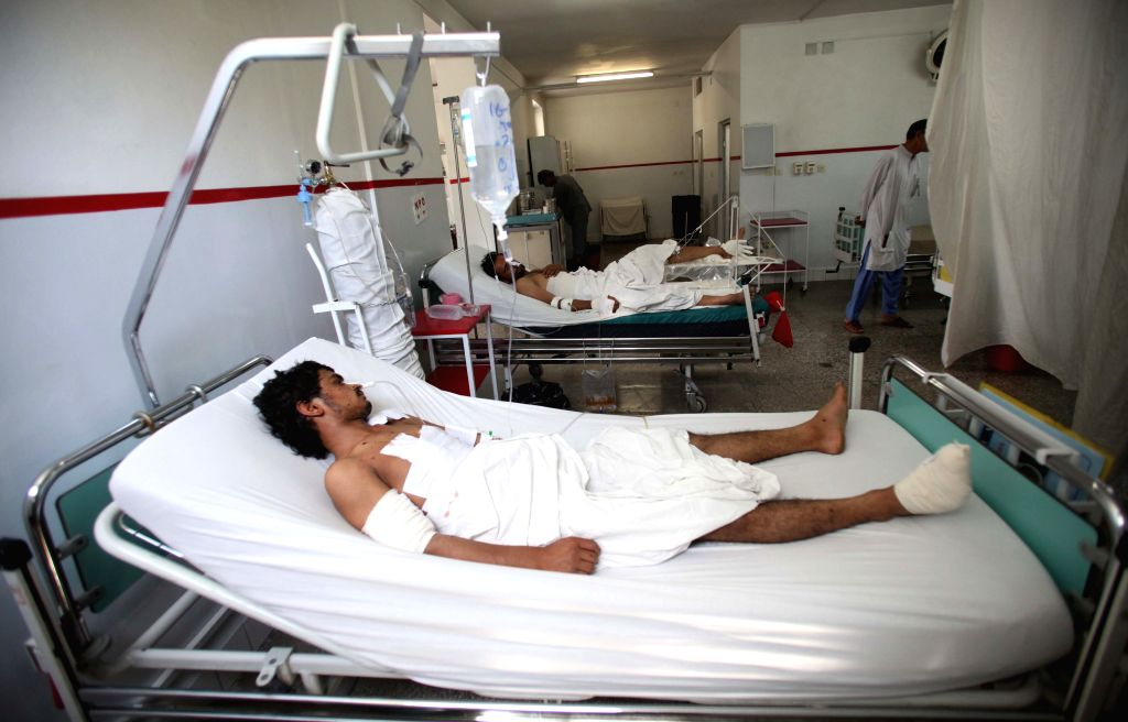 Injured men receive medical treatment at a hospital in Kabul, Afghanistan, July 16, 2014. A vehicle packed with explosives was detonated at a busy market in the ...