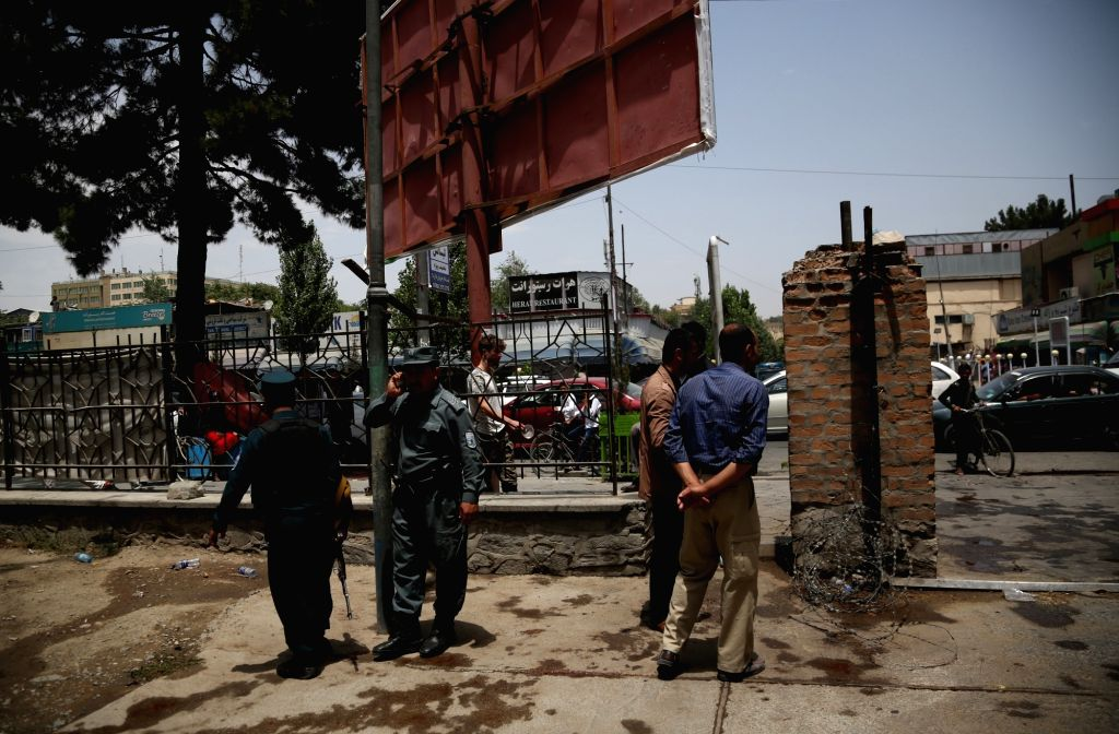 KABUL, July 16, 2018 - Afghan security force members inspect at the site where a would-be suicide attacker was shot and critically injured in Shahr-e-Naw park in Kabul, capital of Afghanistan, July ...
