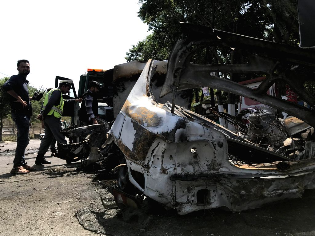 KABUL, July 19, 2019 - Afghan security force members inspect the site of a blast at the southern gate of Kabul University in Kabul, Afghanistan, July 19, 2019. Four people were killed and 16 others ...
