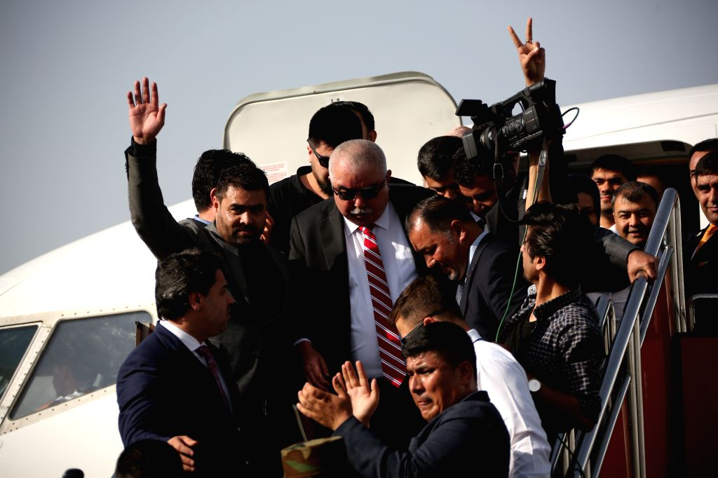 KABUL, July 22, 2018 - Afghan First Vice President General Abdul Rashid Dostum (C) arrives at the Kabul international airport, Afghanistan, July 22, 2018. Afghan First Vice President General Abdul ...